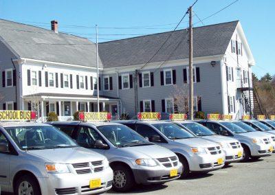 School Bus Vans in Parking Lot