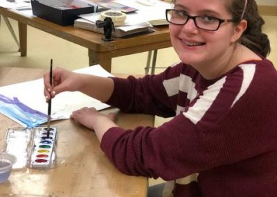 Student at Desk Painting