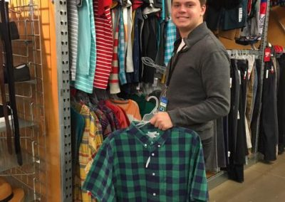 Male student at work in a store